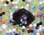 200 Murmeln im Netzbeutel. Bild 1